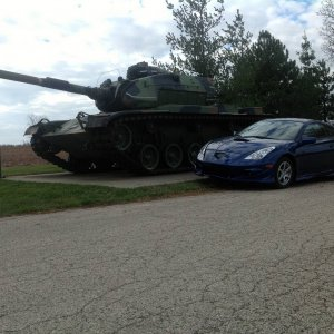Celica by a tank